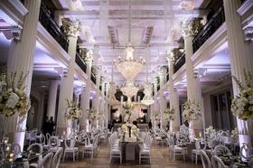 wedding reception at the corinthian in houston white columns purple lighting white flowers modern