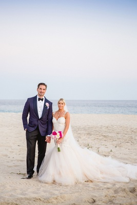 Hockey player Sheldon Souray and WAGS star Barbie Blank white dress and pink bouquets by beach