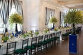 green-cushioned seating, blue-and-white décor long table curtains stripes pattern