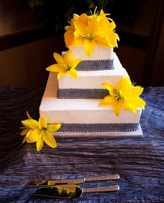 Three layer wedding cake with yellow flowers
