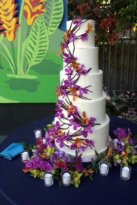 Five layer white cake decorated with orchids