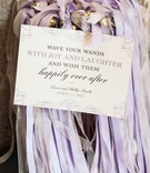 Purple, white, and silver ribbons for waving wands at wedding ceremony