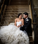 wedding portrait bride in pretty ines di santo wedding dress with ruffle texture skirt groom suit
