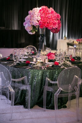 Ghost chairs around green sequin table with ombre centerpiece