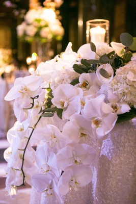 orchids cascading off sweetheart table centerpiece roman catholic wedding reception modern white