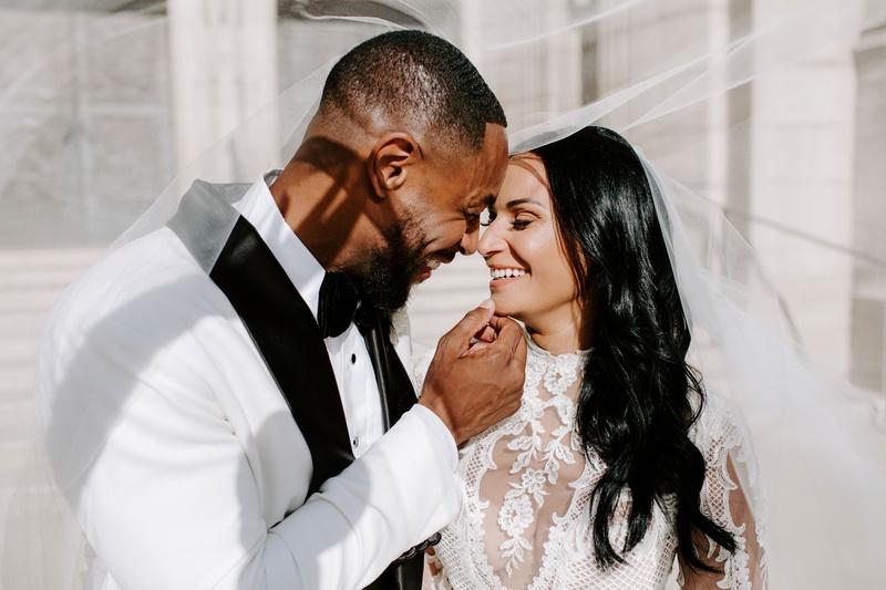 r&b singer tankr zena foster wedding, bride and groom pose under veil