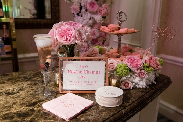 Wedding cocktail hour idea hers station rose and champagne bar pink flowers macaron desserts