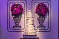 six-tier wedding cake with sugar flowers and lace patterned like the bridal gown