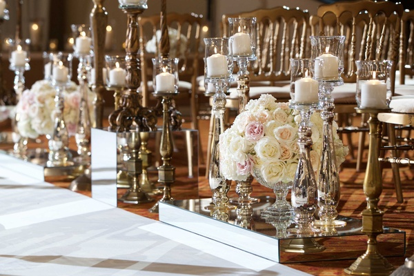 Mirror boxes next to white aisle runner candle holder candelabra white candlelight