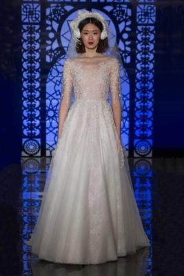 ebe5989b496 Reem Acra Bridal Fall 2016 a-line wedding dress with sheer three-quarter-