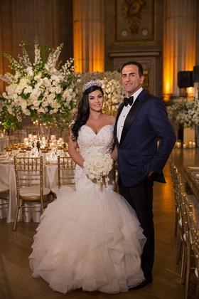 Bride in off shoulder trumpet mermaid gown matthew christopher tiara groom in tuxedo bow tie navy