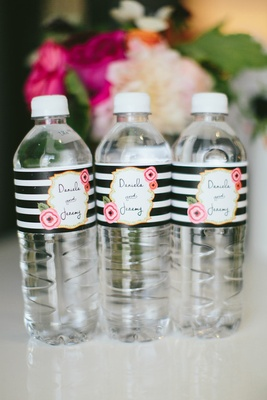 white, black, and gold personalized water bottles for wedding favors gift box