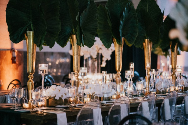 wedding reception table decor ghost chair white napkin green linen elephant ear tropical greenery