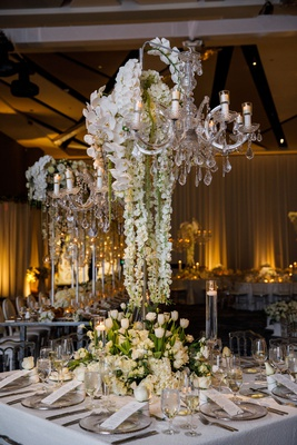 wedding reception square table sequin linen low flowers white hydrangea rose tulip tall chandelier