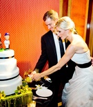 MLB player Steve Finley cutting cake with bride