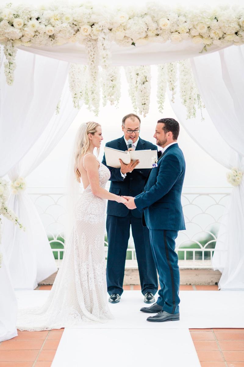 destination wedding in capri, bride in galia lahav wedding dress, groom in navy suit, white canopy