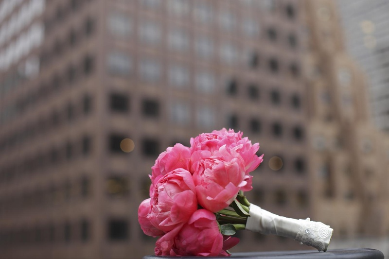 Wedding bouquet with bright pink peonies in NYC