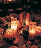Center of table with many candles in various votives