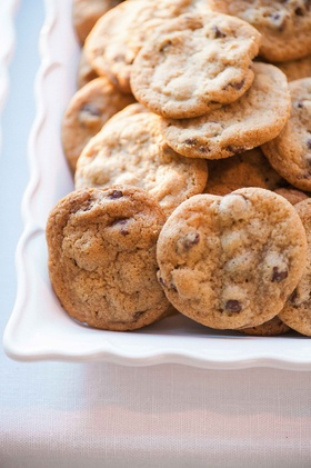 Beach tented wedding reception with SusieCakes chocolate chip cookies at dessert table