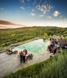 Wedding cocktail hour by a pool overlooking the Tuscan countryside at Castiglion del Bosco
