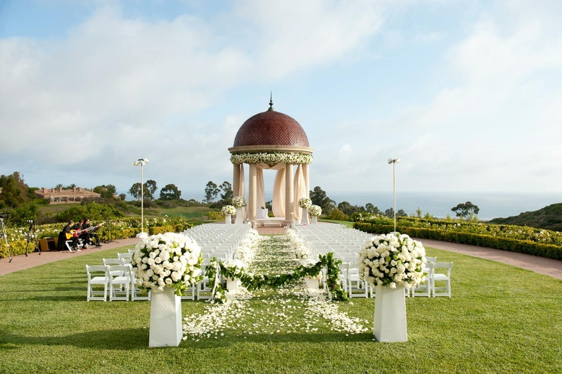 White chairs along petal aisle and rotunda