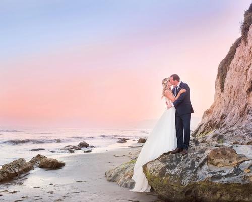 wedding portrait sunset photo of bride and groom flower crown santa barbara beach cotton candy skies