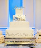 Square white cake with metallic details