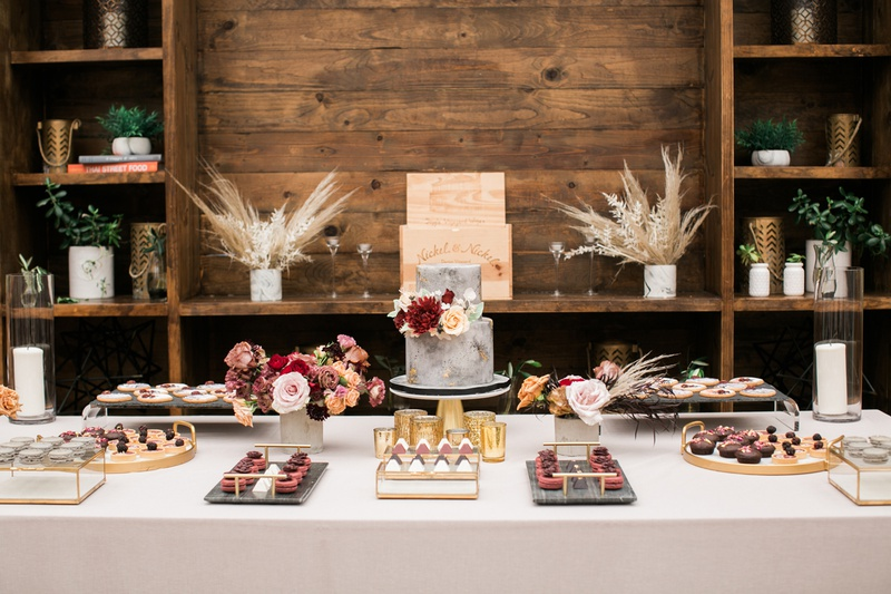 plentiful dessert table at bridal shower with small two-tier grey cake