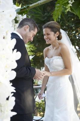 Malibu wedding bride and groom exchanging wedding rings