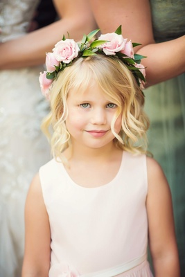 Flower girl in very pale pink tank dress with ivory sash, blonde hair, and pink rose flower crown