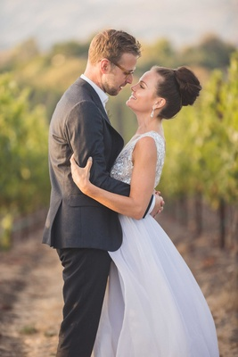 Groom in black grey suit and glasses with bride in Mira Zwillinger wedding dress Carine's Bridal