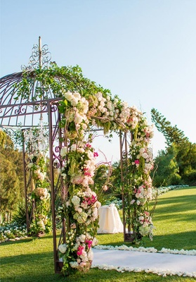 Gazebo Used By Wedding Chuppah Decorated With Flowers And Greenery