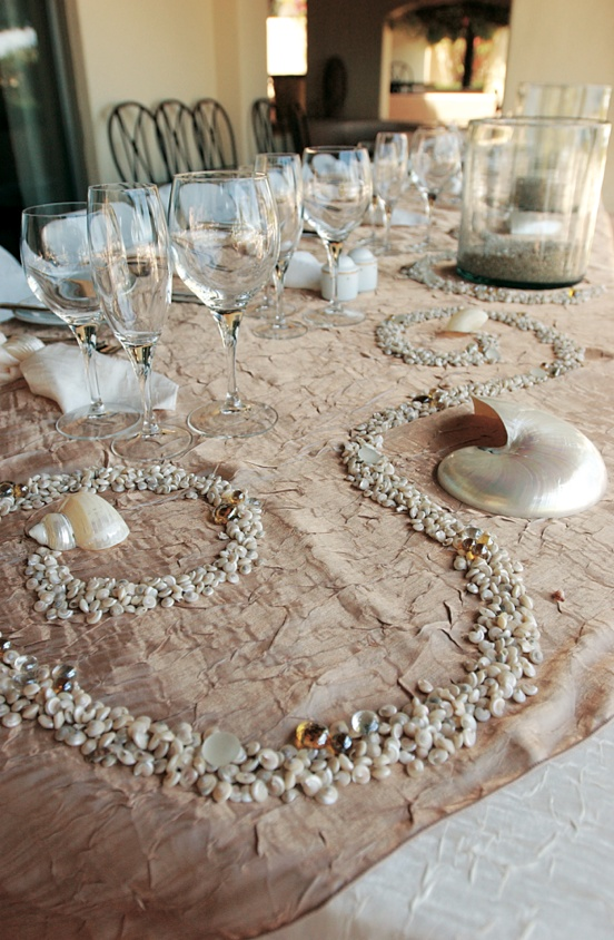 Seashells And Sea Glass On Sand Colored Tablecloth