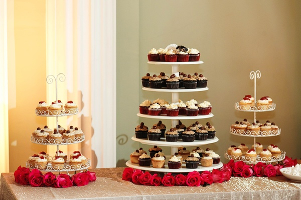 White cake stands with vanilla, chocolate, and red velvet cupcakes