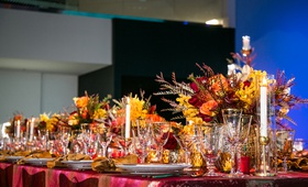 fire inspired wedding styled shoot, floral arrangements in warm colors, orange, red, yellow