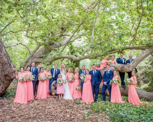 bridesmaids in coral bridesmaid dresses groomsmen in bright blue suits and ties wedding california