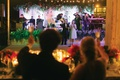 back of bride and groom cheersing champagne toasting parents on stage wedding toast photo