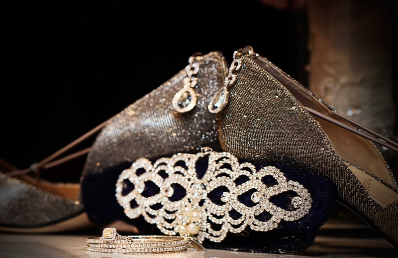 Metallic wedding shoes, crystal clutch, halo drop earrings, bangles, and yellow diamond ring