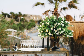 wedding reception bar tulip flower arrangement black vessel champagne flutes on tray mirror bar
