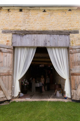Iowa barn wedding ceremony entrance with drapes and wood doors