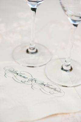 White beverage napkins with wedding couple names