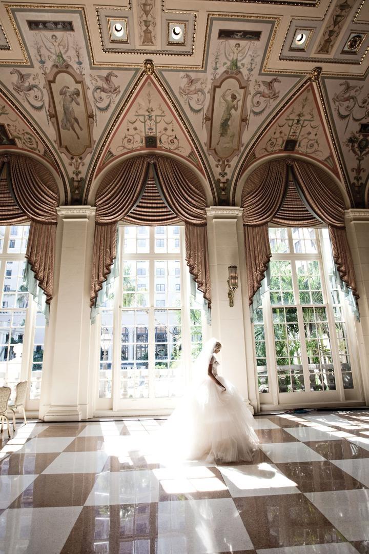 Bride walking through Mediterranean Ballroom at The Breakers