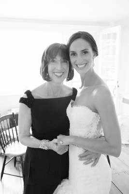 Black and white photo of bride in Pnina Tornai for Kleinfeld wedding dress holding mother of bride