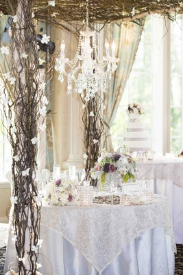 Branch arbor and chandelier over sweetheart table