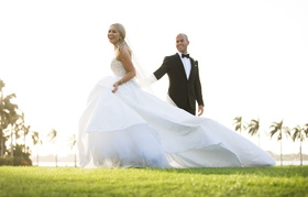 Bride in strapless ball gown with long train with groom in tuxedo Palm Beach Florida