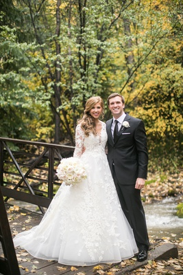 bride in lace isabelle armstrong a-line gown, bride and groom in forest