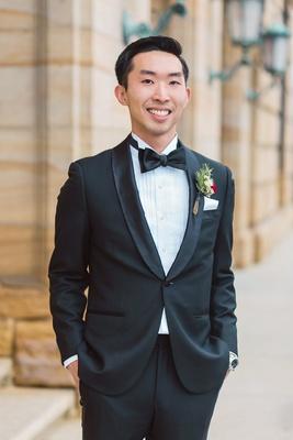 smiling groom tuxedo boutonniere dayton ohio wedding bow tie venue classic style