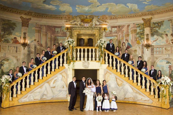 Wedding party on The Pierre staircase with painted walls