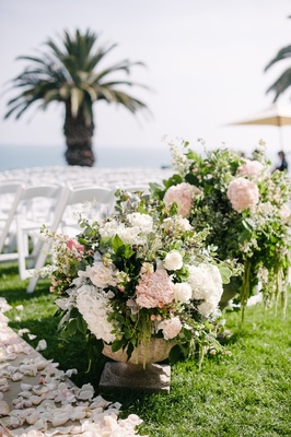 lush floral arrangements with blush and white flowers, heavy greenery