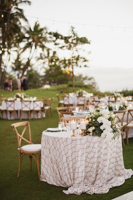 maui destination wedding, outdoor reception, vineyard chairs, patterned linen sweetheart table